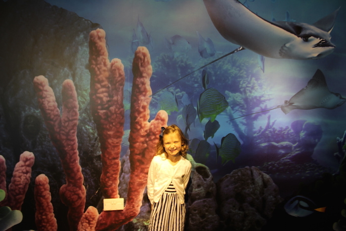 Bella at the entrance of the London Aquarium