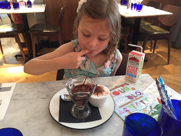 Bella eating her dessert