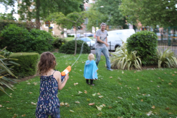 Family using water gun 4