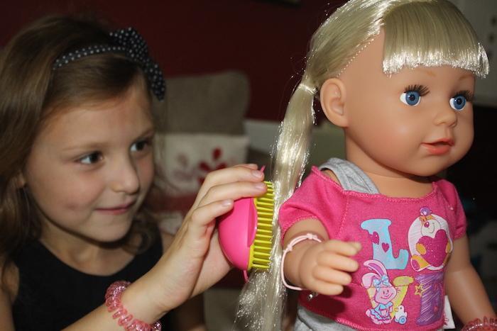 Bella brushing doll's hair