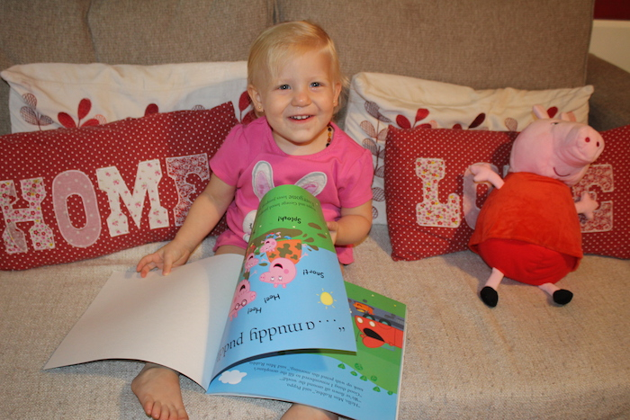 Sienna happy with her Peppa Pig book