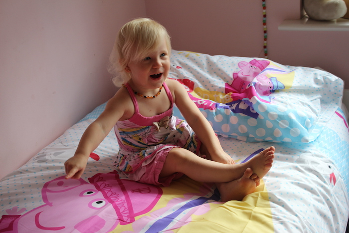 Sienna happy with her new Peppa Pig duvet set