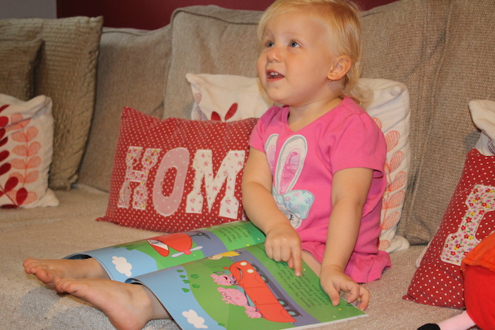Sienna happy with new Peppa Pig book