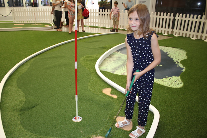 bella-playing-mini-golf-1
