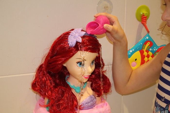 bella-pouring-water-on-ariel-styling-head-no-changes