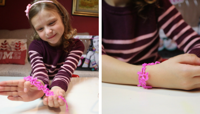 bella-showing-pink-bracelet