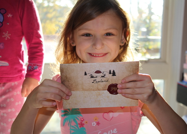 bella-excited-with-letter-from-santa