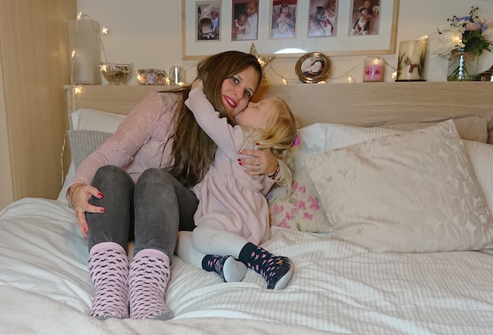 Daughter kissing mummy while wearing Quality Hand-Sewn Scandinavia Moccis