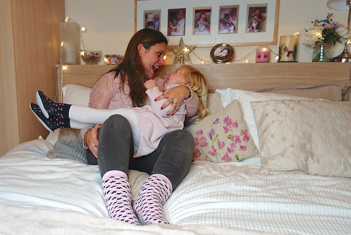 Mummy and Daughter having a playful moment while wearing Quality Hand-Sewn Scandinavian Moccis