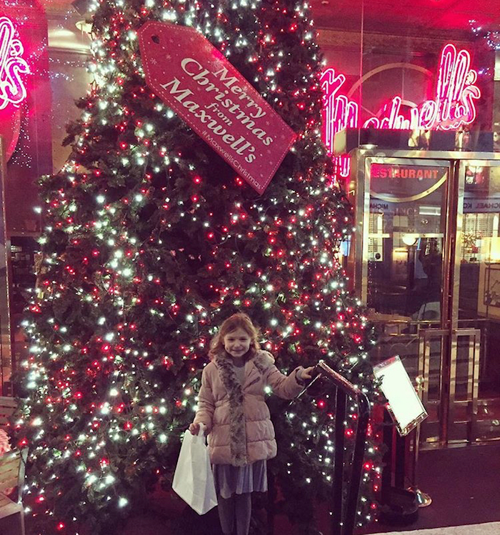 Treated.com - My daughter Bella in front of a Christmas tree in Covent Garden London