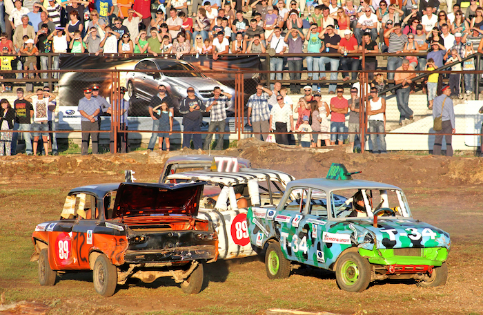 UFA, RUSSIA - AUGUST 1: Undefined competitors' Moskvitch-412 No. 12 and No.102 take part at the Arena 89 Demolition Derby on August 1, 2012 in Ufa, Russia.