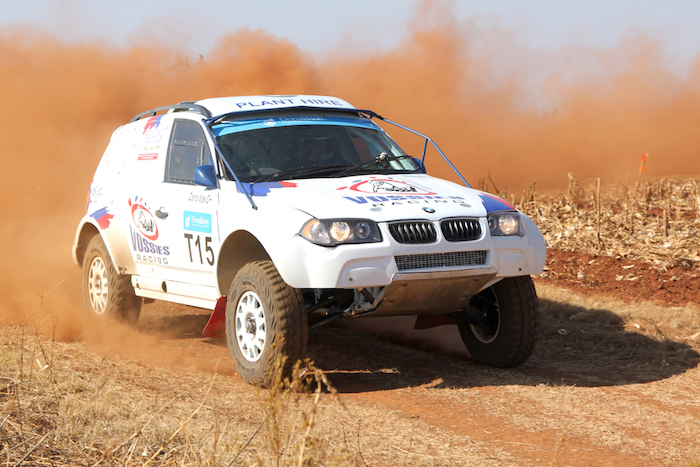 BRITS, SOUTH AFRICA - July 11: Africa-Offroad Racing Rally, on July 11, 2015 at Koster, North West Province, South Africa. Drifting white BMW rally car kicking up dust on turn.