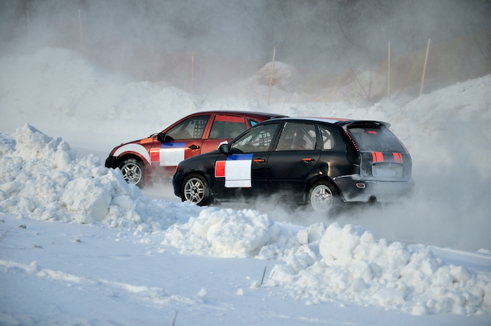 Two cars together on an input in turn track, automobile ice on race